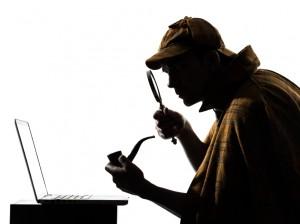 sherlock holmes inspecting computer keyboard